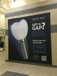 A brilliant example of a disrupter at work; a large advert for £995 implants seen at Liverpool's John Lennon airport